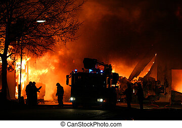 Fire fighting men - Firemen in action at a major fire