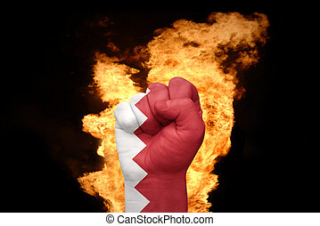 fire fist with the national flag of bahrain