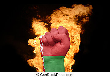 fire fist with the national flag of belarus