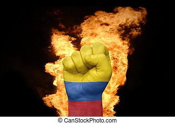 fire fist with the national flag of colombia