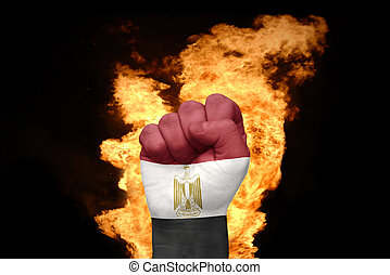 fire fist with the national flag of egypt