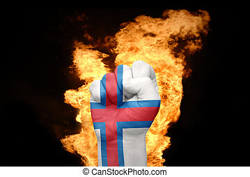 fire fist with the national flag of Faroe Islands