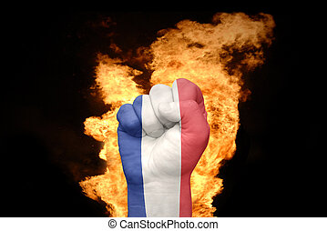 fire fist with the national flag of france