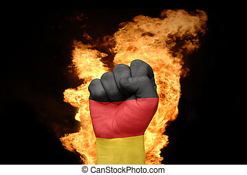 fire fist with the national flag of germany