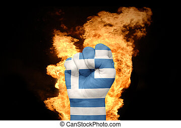 fire fist with the national flag of greece