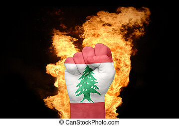 fire fist with the national flag of lebanon