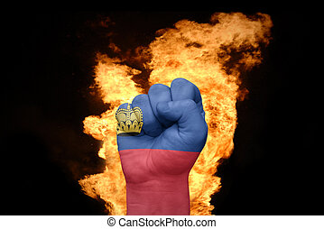 fire fist with the national flag of liechtenstein