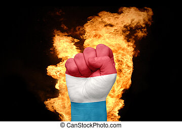 fire fist with the national flag of luxembourg