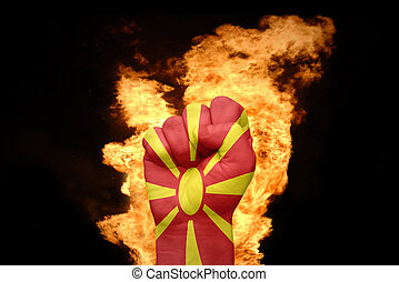 fire fist with the national flag of macedonia