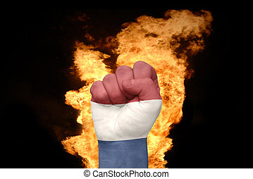 fire fist with the national flag of netherlands
