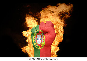 fire fist with the national flag of portugal
