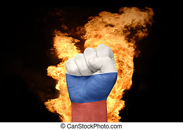 fire fist with the national flag of russia