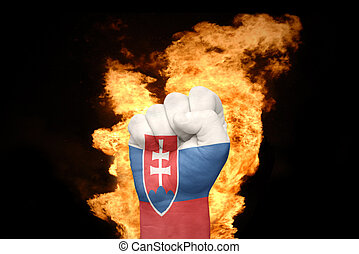 fire fist with the national flag of slovakia
