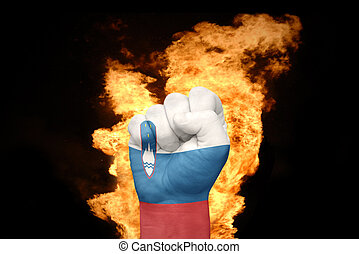fire fist with the national flag of slovenia
