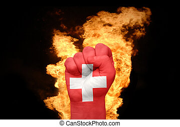 fire fist with the national flag of switzerland