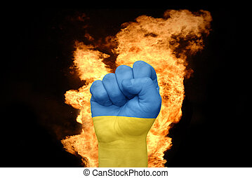 fire fist with the national flag of ukraine