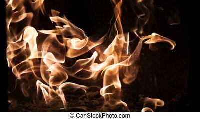 Fire flames and sparks in slow motion on black background