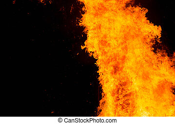 Fire flames on a black background with copy space