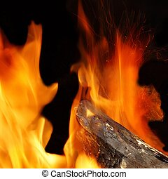 Fire, Flames, Sparks and Glowing Coals in a BBQ or...
