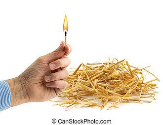 fire hazard - hand holding a burning matchstick near a ...