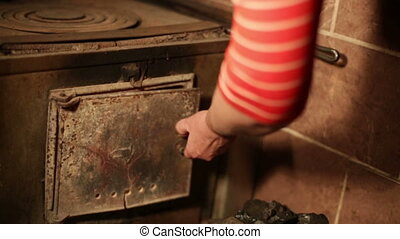 fire hearth of russian oven and old cast-iron pot