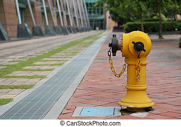 fire hydrant - yellow fire hydrant infront of modern...