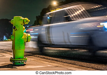 Fire Hydrant with truck blurred behind