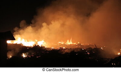 Fire in a field at night