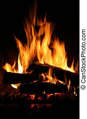 Fire in a fireplace - Fireplace and flames details. Small ...
