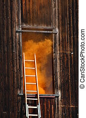 fire in a House with thick orange smoke coming out from the