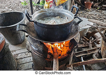 Fire in a stove between cooking