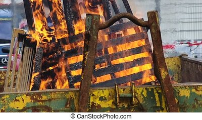 fire in a waste container