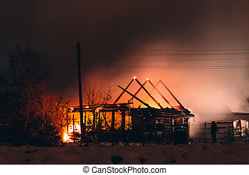 fire in a wooden house at night