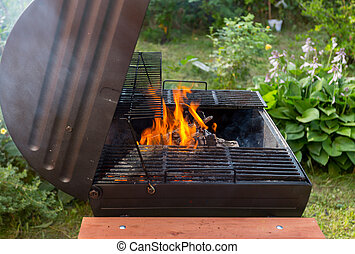 Fire in barbecue grill