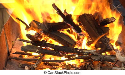 Fire in barbecue place - Hot fire in barbecue place. Flame...