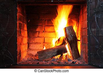 Fire in burning fireplace in winter