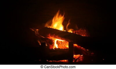Fire in fireplace - Burning and glowing pieces of wood in...