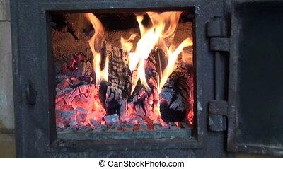 fire in old farm furnace fireplace