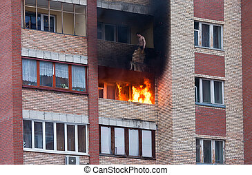 Fire in one of the apartments of a large tenement-house