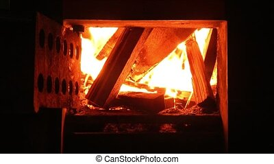 Fire in the fireplace or in the hearth of the stove