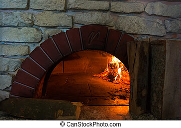 fire in the oven. Traditional Pizza oven