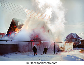 fire in the winter country house photo