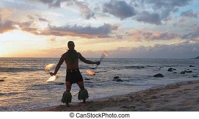 Fire juggler juggling fire sticks in the beach 4k - Fire...