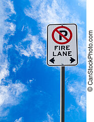 Fire Lane No Parking Sign Against Blue Sky