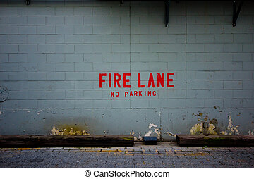 Fire Lane - Backdrop image of a grungy urban wall indicating...