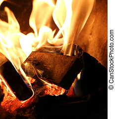 fire made with pieces of dried wood inside the kitchen stove