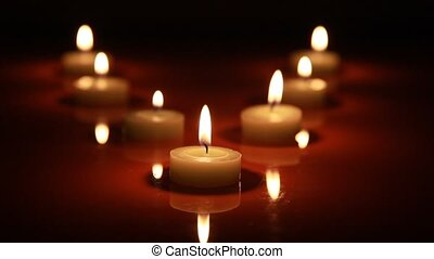 Fire of the candle natural of light - Three candles, grouped...