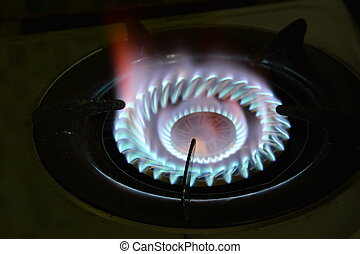 fire on gas stove in kitchen