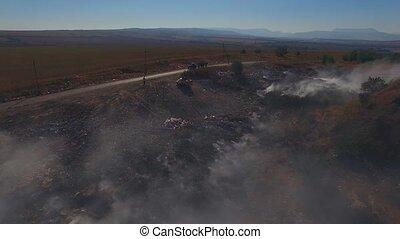 Fire On Huge Garbage Dump - AERIAL VIEW. Huge dump is in...