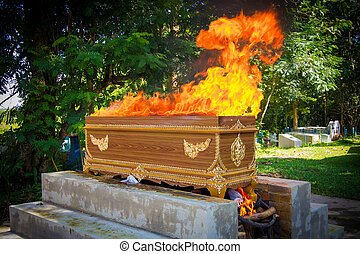 fire on the coffin for cremation, thai tradition